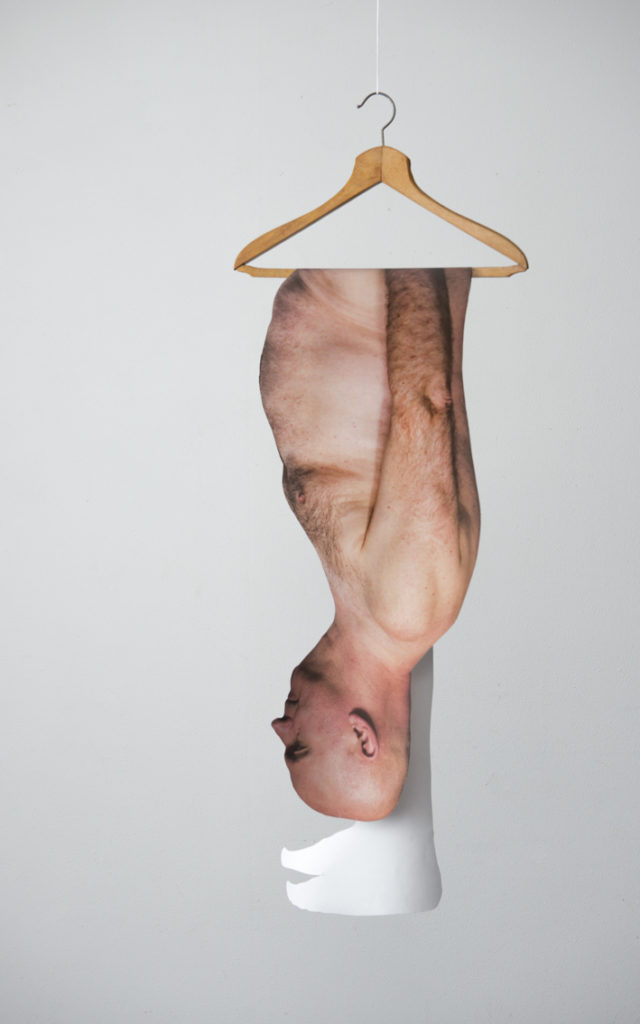 photocopy of whole body in full size hung on a clothes hook