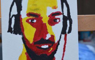 resultaat van een mannenportret in Andy Warhol Pop art stijl in geel, rood, wit en zwart